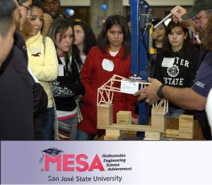 Students watch as judges test a bridge at MESA Day 2010.