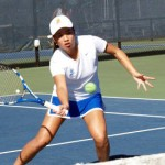 Spartan female tennis player on the court.