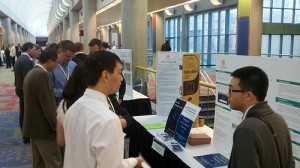Recent graduate Andy Tran (right) discusses his startup with a local business leader.