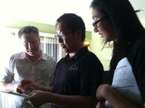 Environmental studies graduate student Anna Le and engineering graduate student Gordon Poon explain usage of electricity, natural gas and water on a utility bill to a San Jose resident.