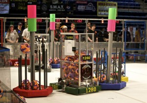 Palo Alto's Gunn Robotics Team, seen here in red costumes at the 2008-09 Silicon Valley Regionals, has competed in the FIRST Robotics Competition since 1996. Photo courtesy Gunn Robotics.