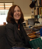 Mary Pickering in her office surrounded by books.