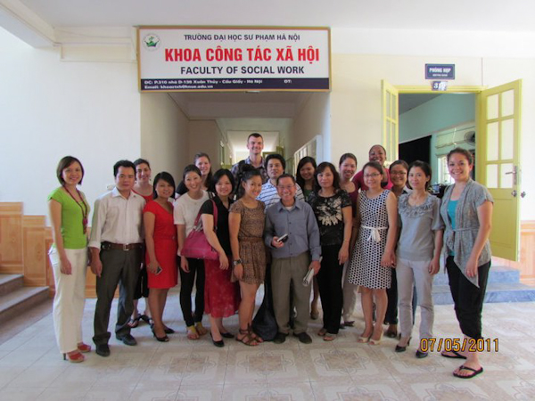 SJSU Students pose with the Faculty of Social Work in Hanoi, Vietnam. Photo by: Iliam Parra