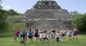 Nursing students jump as a group in front of a pyramid, Xunantunich Mayan ruins, in Belize. Photo by Paige Le.
