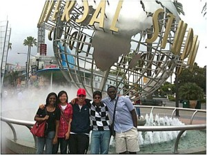 Students posing in front of iconic Universal Studios signage.