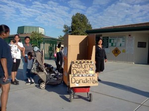 Custom-made cardboard box on a wagon in a school yard.