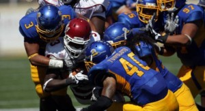 SJSU defense crushes New Mexico ball carrier.