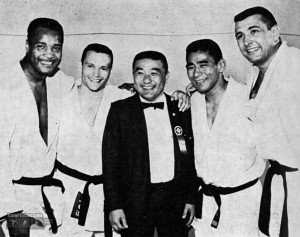 Yoshihiro Uchida at the 1964 Tokyo Olympics with George Lee Harris, Jim Bregman, Paul Maruyama and Ben Nighthorse Campbell, who went on to become a U.S. senator (courtesy of Bruno Carmeni's Judo Blog).