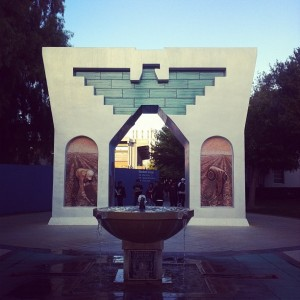 Photo of the Cesar Chavez monument on campus with the water fountain running.