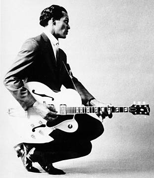 black and white photo of a young Chuck Berry and guitar