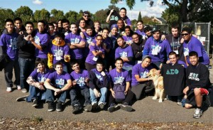 Members of Delta Sigma Phi fraternity gather around and pose for the 5th Annual Day of Service.