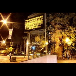 "A photo taken at night from fifth street looking at a sign that says ""San Jose State University"""