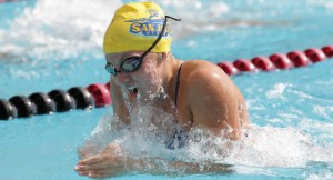 SJSU Spartan Darcie Anderson is swimming in a pool wearing her SJSU swimming cap and goggles.