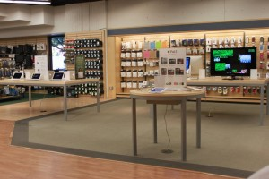 A picture of the technology including demonstration tables that feature Apple products, inlcuding IPad 2's and MacBook Pro Air