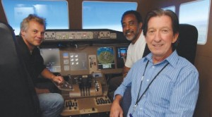 image: Jordan and colleagues in 777 simulator
