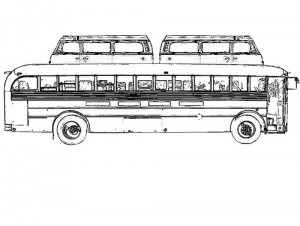 Pictured here is The Photo Palace Bus that has two Volkswagon Station Wagons mounted on the top.
