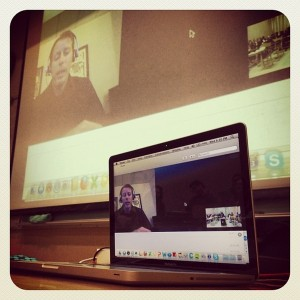 A computer is connected to a projector displaying a Skype conversation with CEO of Fancorp, a brand advocacy company. The guest speaker was for Michael Brito's Developing Strategies for Socia Media Class.