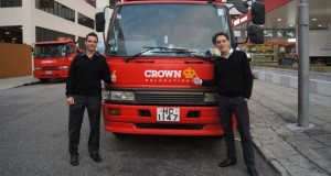 two students with Crown truck in Hong Kong