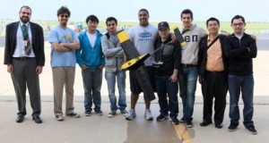 group shot of team with model airplane