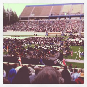 Photo taken from Spartan Stadium of football field with chairs and graduates. Photo by @tracyottey