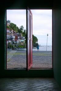 looking through open door onto beach and barrios