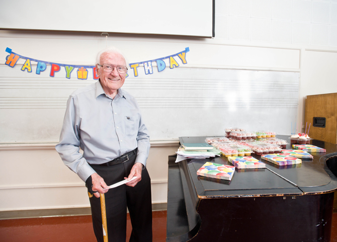 90-year-old man poses with birthday treats