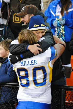 fan hugs player