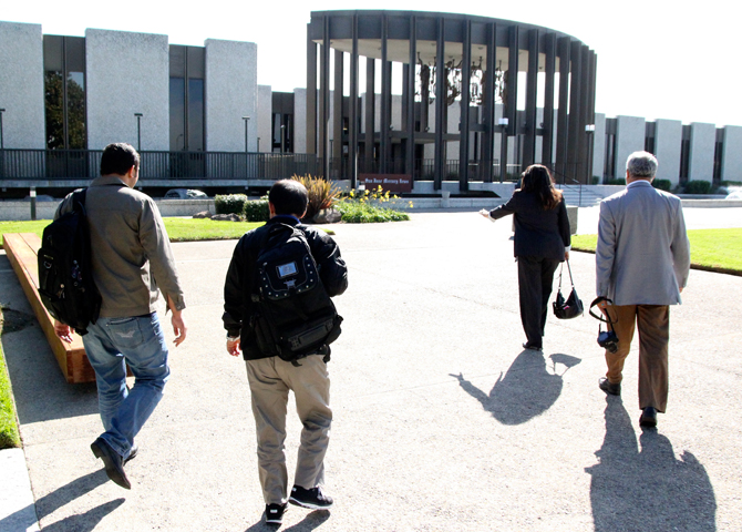 Three men and a woman walking toward the San Jose Mercury News building. Photo by Jessica Olthof.
