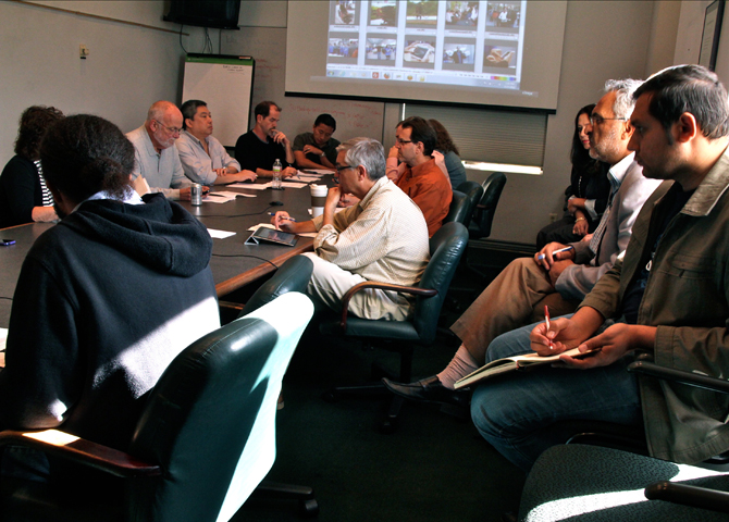 Newsroom meeting at San Jose Mercury News with people around a conference table. Photo by Jessica Olthof.
