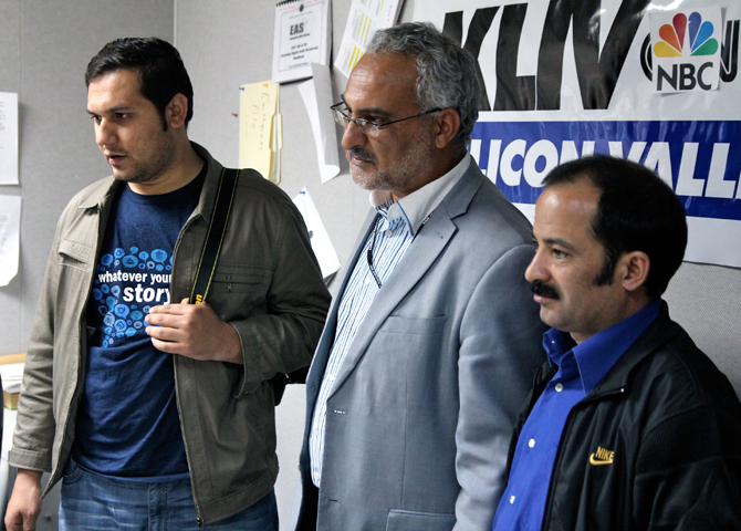 Three men with KLIV 1590 radio station banner in background. Photo by Jessica Olthof.