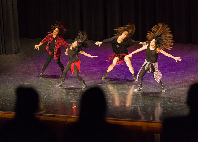Dance crew performs a hair whipping performance