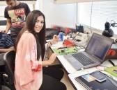 Melissa Ortiz at the computer.