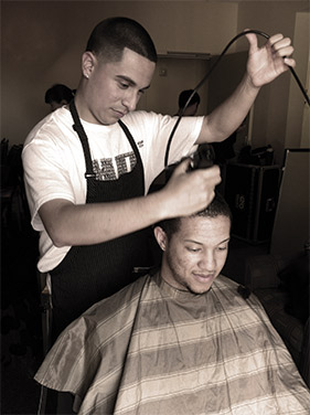 Pedro Garcia cutting hair