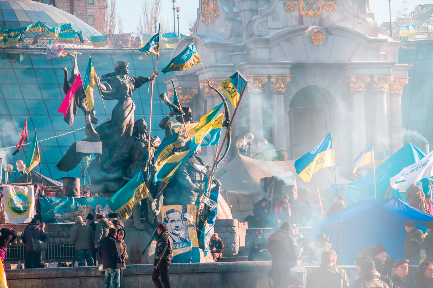 Located in Independence Square, the monument to the founders of Kyiv is covered in protester flags. Photo: Demotix.com.