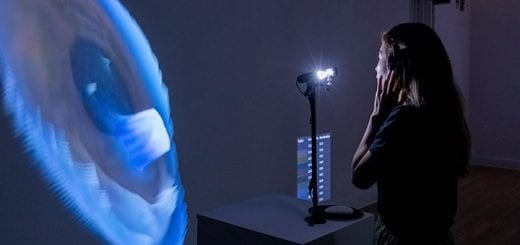 Designer Yoon Chung Han's stands in front of a machine that scans and projects an image of your iris.