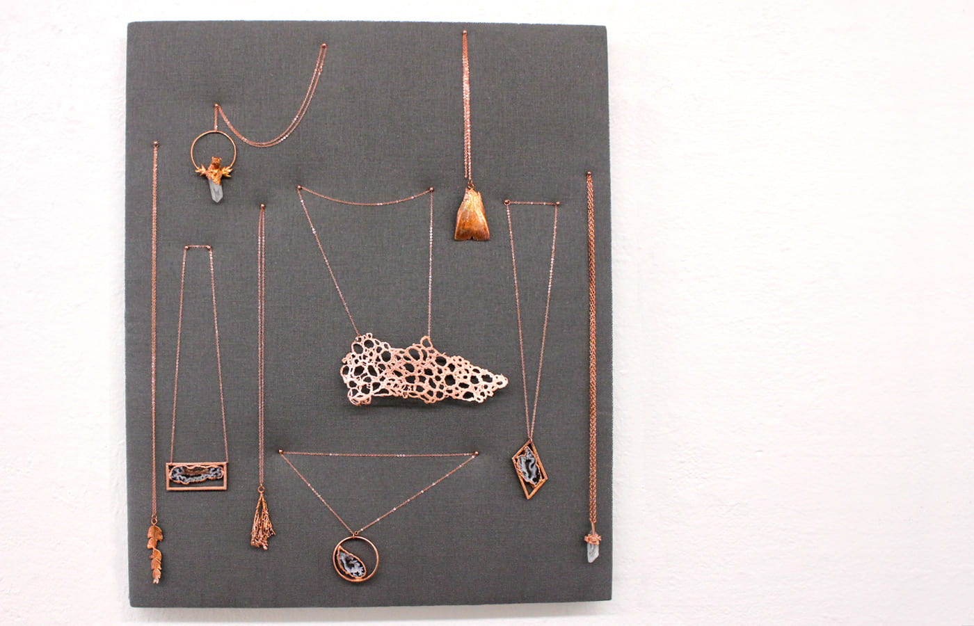 Display of brass electroform jewelry created by SJSU students.