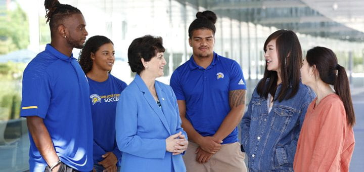 President Mary A. Papazian chatting with students.