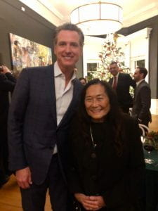 Jeanne Houston & Gavin Newsom are standing together