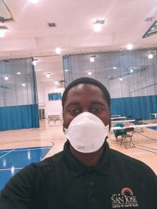 Darius Brown wears a face mask on the COVID-19 frontlines
