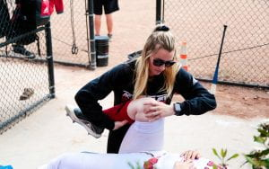 Annie Ronning holds an athlete's knee
