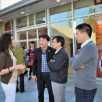 Social Work graduate student Veronica Cavillo talks with visitors from Vietnam at the Social Work Education Enhancement Project Fellows' reception March 4.