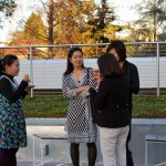Health Science Professor Jane Pham, second from the left, and Social Work Professor Meekyung Han, second from the right, talk with visitors from Vietnam during the Social Work Education Enhancement Program Fellows' reception March 4 on the Yoshihiro Uchida Hall rooftop terrace.