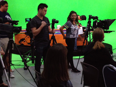 Students involved in the Update News broadcast ask questions of SJSU's president and provost at a news conference.