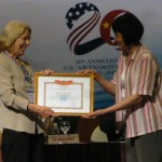 Dr. Alice Hines, left, accepts an award for SJSU's work on enhancing social work education in Vietnam.