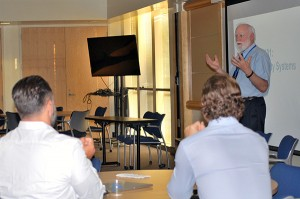 Dennis Jaehne, front right, welcomes new faculty members to University 101.
