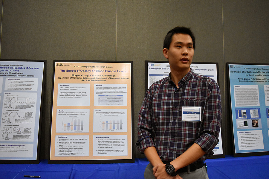 Morgan Change explains his research project to a faculty member at the Celebration of Research on Feb. 10.