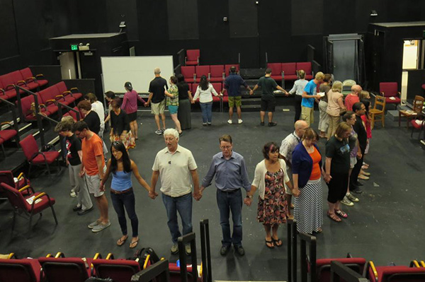"""Photo courtesy of Matthew Spangler Dr. Matthew Spangler, center right in gray, and Dr. David Kahn, center left in white, lead participants of a 2014 summer institute, """"The Immigrant Experience in California through Literature and Theatre"""" through a performance exercise. The pair will host the program this summer with a National Endowment for the Humanities grant."""