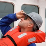 Ivano Aiello, a sedimentologist, reacts to the rather loud ship's horn that is sounded during weekly life boat drills.