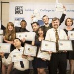 Spartan Daily student staff members hold up awards from the February California College Media Association's Award Banquet, with Professor Richard Craig, second from the right.