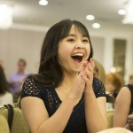 Linh Nguyen, an SJSU student, reacts to the announcement of a Spartan Daily Award at the California College Media Association's Award Banquet.